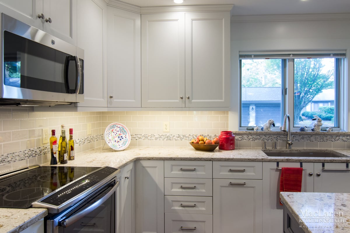 windermere quartz countertops and mouser cabinetry with praxton